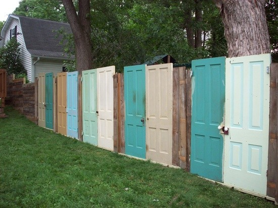 A yard FENCE made out of DOORS