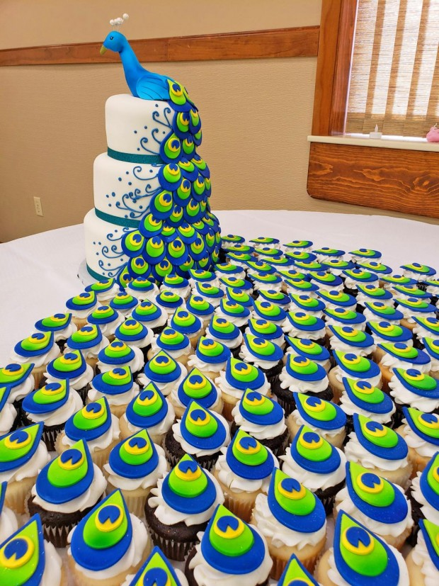 This Amazing Peacock Wedding Cake Uses Cupcakes For The Tail