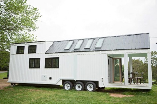 The Roost 36 by Perch & Nest features two bedroom lofts and a large deck made from 100% recycled materials